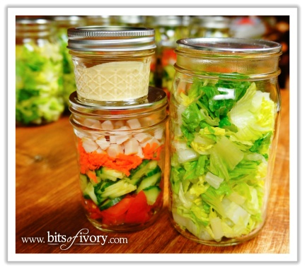 Lettuce, salad toppings, and salad dressing in various canning jars | www.bitsofivory.com