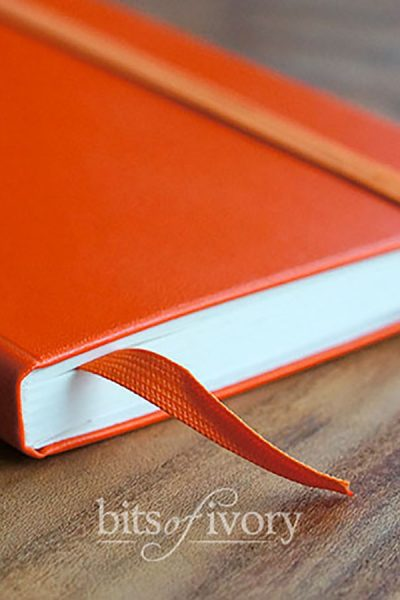 Orance notebook with bookmark
