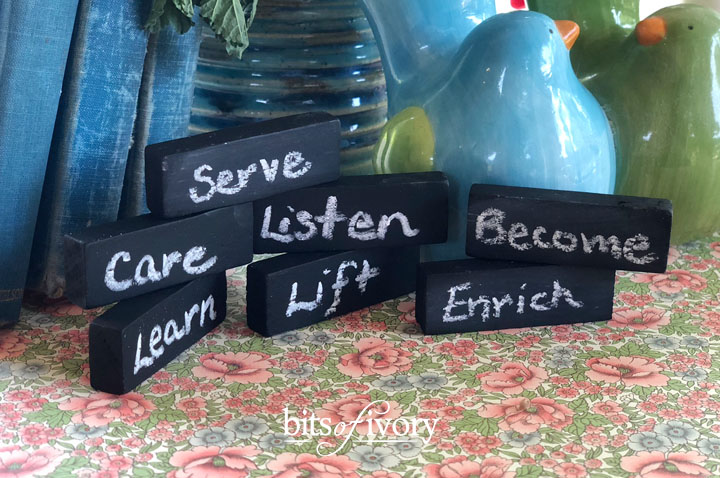 Mini chalkboards from old game pieces with words written on them