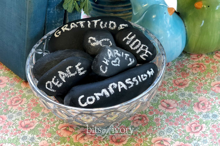 A bowl of chalkboard stones with encouraging words written on them